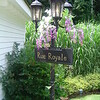 Mardi Gras- French Quarter Street Sign with white and purple flowers. <br /> Tent Party in Madison, CT