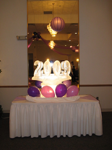 Purple Prom- The 2009 ice carving is lit from behind. The mirror reflects the dance canopy and hanging lanterns.  <br /> Maneeley's in South Windsor