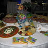 Beach Birthday Party- This Tuscan appetizer table carries the beach theme with conch shells, decorative fish, a small lighted palm tree and colorful beach themed napkins.<br /> Maneeley's in South Windsor