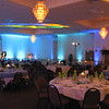 Beach Birthday Party- Awesome Audio provided the lighting for this party.  This level of lighting requires a lot of time.  It took 3 guys most of the day to set up this room with uplights and ceiling lighting.  It's difficult to get the effect in this picture, but with the lights down it gave you the feeling you were in a lovely blue aquarium!  The tables were covered in blue and white with lime green, yellow and blue napkins.<br /> Maneeley's in South Windsor