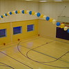 Balloons-String of Pearls Balloon Arch over a Gym from above. <br /> Courthouse Plus in Manchester