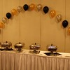 Balloon Arch- String of Pearls Balloon Arch in Gold, Silver and Black behind the buffet table at an Adult Birthday Party.<br /> Maneeley's in South Windsor