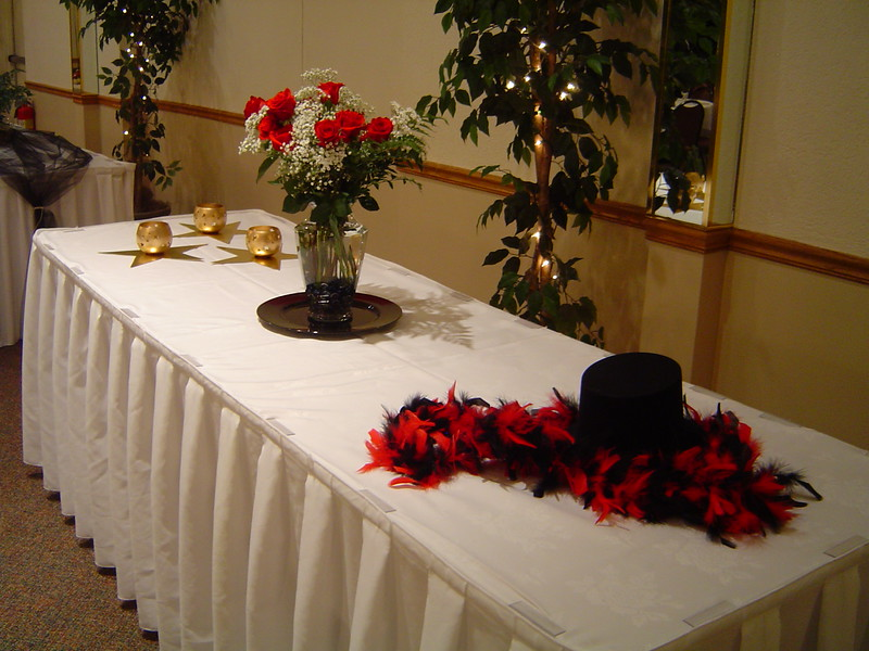 Hollywood- Display table with stars, flowers, boa and top hat.<br /> Maneeley's in South Windsor