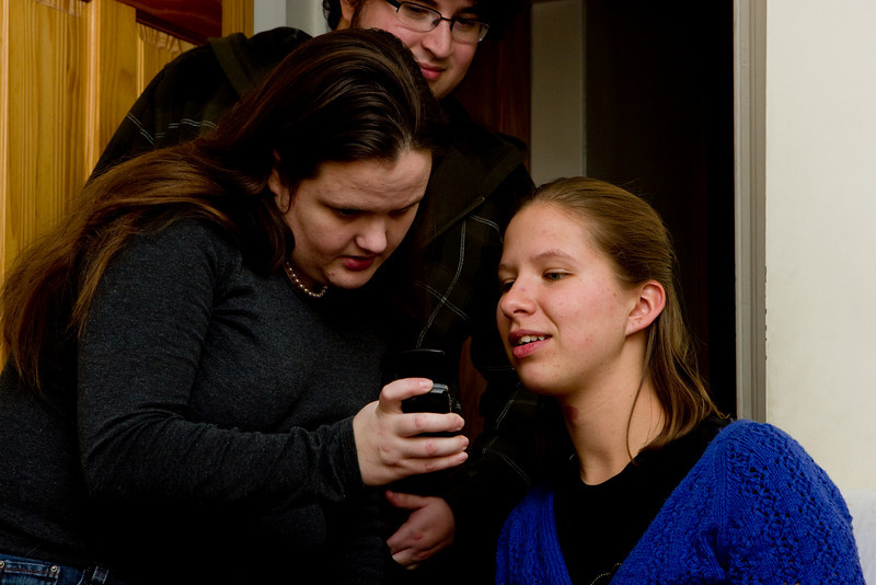 Abby, Jess, and Procto checking out pictures from Windsor Button.