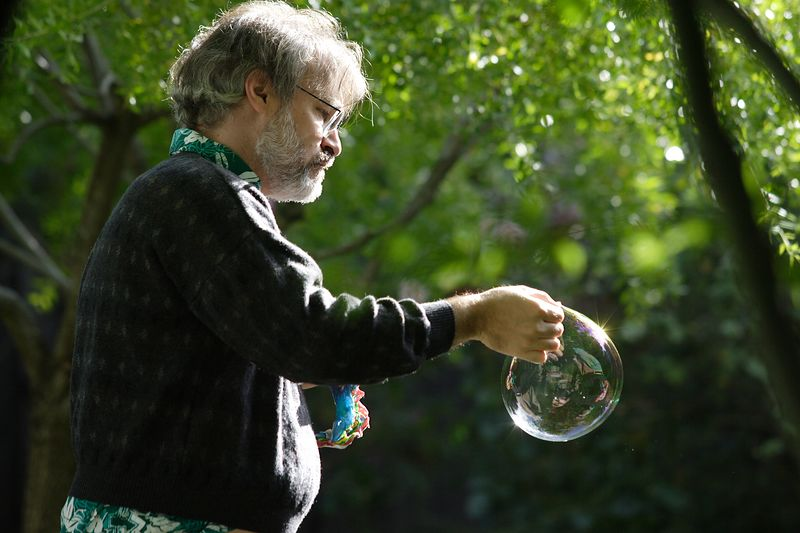Christopher can release and then catch his bubble creations