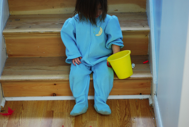 Esme and her bucket on the steps