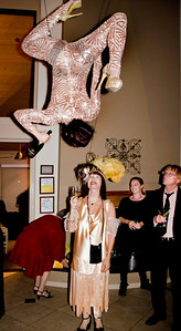 Female acrobat suspended from rope and pouring wine for Sheila Ash  - Sheila Ash birthday party