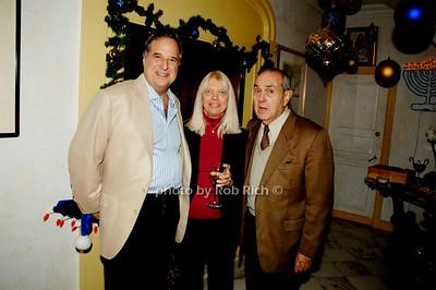 Stewart F. Lane, Pat Schmitt and Stanley Schmitt