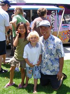 Steve Asahino, posing with his daughter and the youngest son of Steve Dawson.  Surprisingly, though much different in age, all three are about the same height!