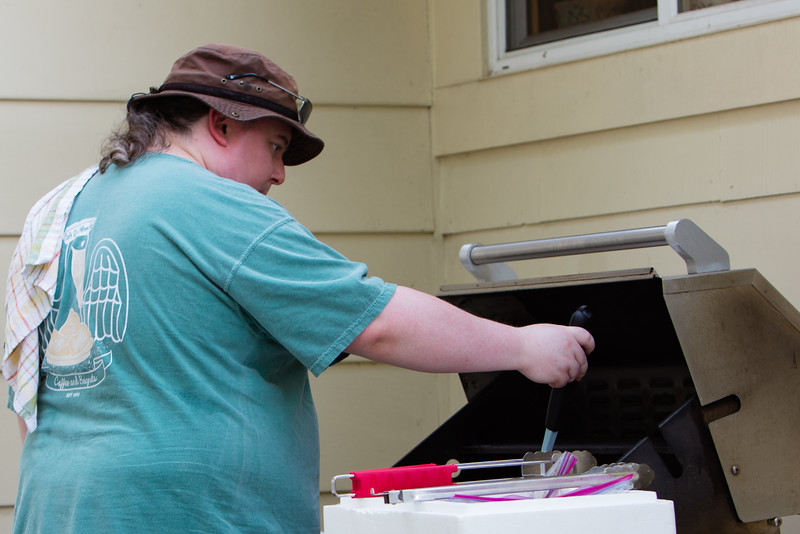 Tim ,hard at it,cooking the chicken.