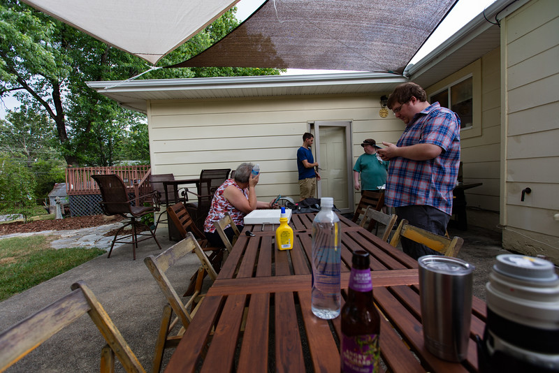 The beginings of the party,Frank and Katie ,Evan and Tim worked getting the yard ready,Tim already has the chicken started,I am now on my second Angry Orchard ,there is a nice breeze blowing,what a great Day.