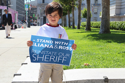 "Theo, displaying a ""Stand with Eliana and Ross"" sign.  He found this sign on his own and then decided to show it to me without prompting.  San Francisco City Hall, September 9th, 2012, noon."