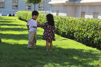 Aisha gives Theo the leaf.  San Francisco City Hall, September 9th, 2012, noon.
