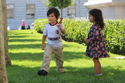 Theo marches off with their new found leaf to show it to the adults.  San Francisco City Hall, September 9th, 2012, noon.