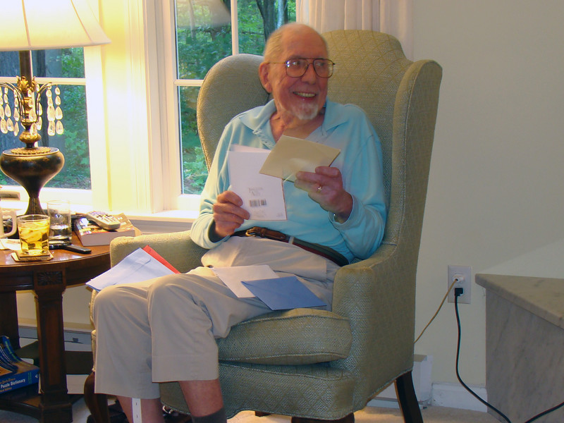 Walter opening some of the many cards he received.