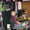 Scott playing the drums at The Iron Wheel Pub