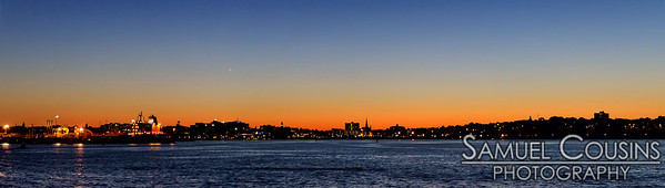 A wide panorama of the sunset over Portland.  The bright spot in the sky (a little left of center) is the planet Mercury.