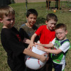 Zac and Joshua had a ball playing with their friends in the back yard.