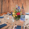 Spring florals, as if they were picked out of the garden of Boone Hall, complete with tea stained flags, gave an Americana look to the room.