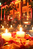 Thousands of rose petals, mixed with hundreds of candles, accented locations throughout the party.