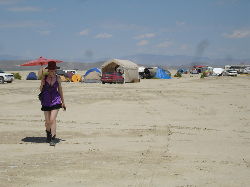 there were only a few hundred people on the playa, all spread out. here's helen, looking for a bush i think.