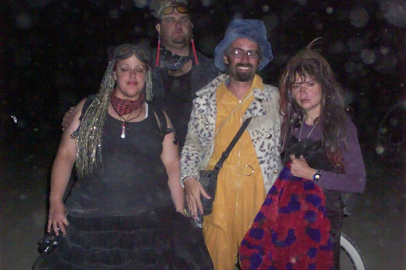 tom's enthusiasm for burning man burns brightly through all hardships. here are my panty campmates on the night of the burn.