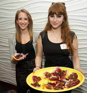 Gracia Goldberg and Erica Turner serve a Raddichio Cup with Orange, Black Olive, Fennel Relish withCrispy Prosciutto at Taste of the World