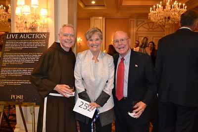 Father Matt Elshoff with Patti and Mike Smith