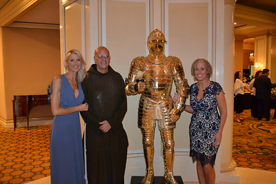 Christa Durfee and Alicia Lund with Father Tony Marti.