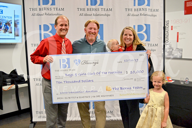 Boys and Girls Club of the Foothills received the grand donation of $10,000. Executive Director John Wilson accepted the check from Jason and Laura Berns.