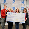 John Burroughs High School Instrumental Music Association receives donation from the Berns Team.