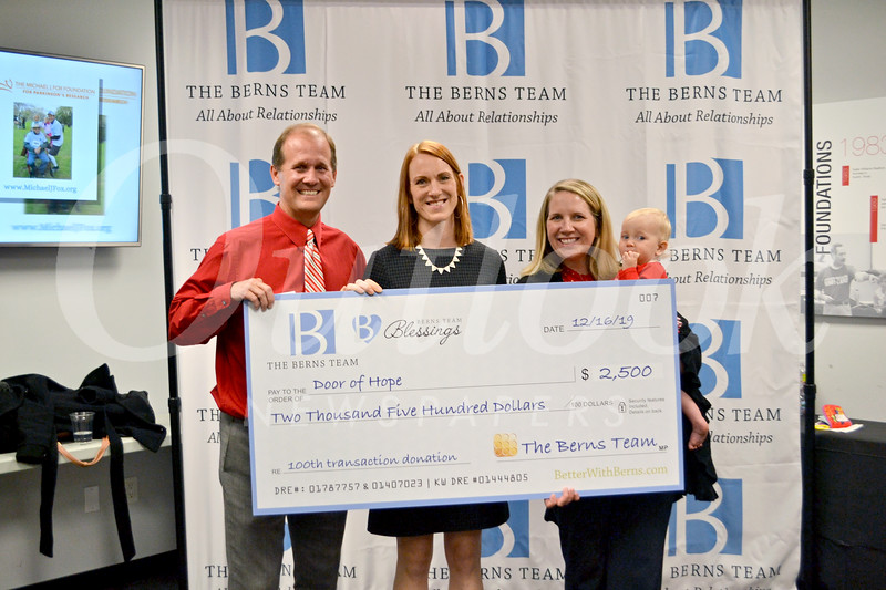Megan Katerjian from Door of Hope receives donation from Jason and Laura Berns