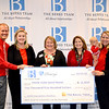 The team from Monte Vista Grove Homes was on hand to receive the donation from the Berns Team.