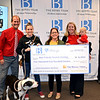 Best Friends Animal Society happily receives donation