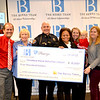 Pasadena Police Activities League happily receives a donation from the Berns Team.