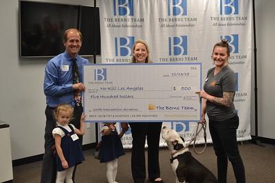 DSC_ Megan Smith from No Kill LA receives donation from Jason and Laura Berns 1651