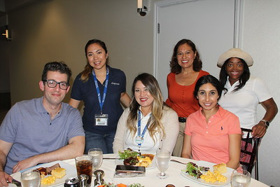 Steve Abramson (seated, from left), Yvette Lopez and Charleen Mikail. Back: Bianca Gonzalez, Lorgia Orozco and Paula Blanchard.