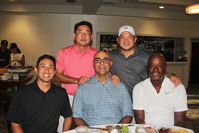Alvin Kwong (seated, from left), Sajid Ahmed and Eric Brown. Back: Keith Matsutsuyu and Johnny Lam.