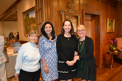 Guest speaker Mary Lea Carroll, President Laura Aguirre, and event co-chairs Mary Mather Nally and Mary Nally Ternan.