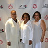 Emcee Phlunte' Riddle, event co-chair Charmayne Mills Ealy and Board President Debra Ward-Samad