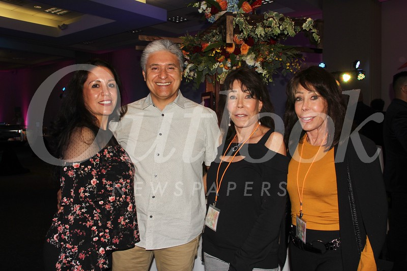 Maria Gonzalez, Gustavo Alcala, and twin sisters Elaine Rothman and Judy Geller