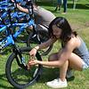 DSC_ Sasha Chan tightens wheel  0211