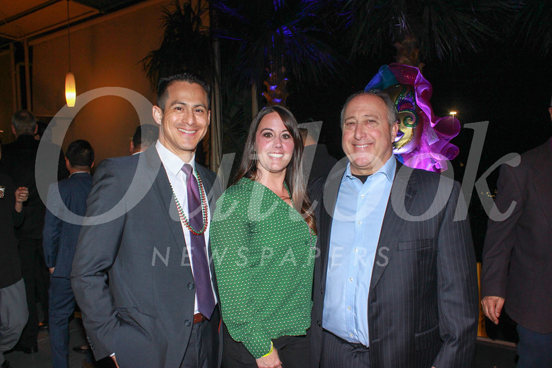 David Orellana, Julie Guyon and hospital Senior Vice President and Chief Strategy Officer Cliff Daniels