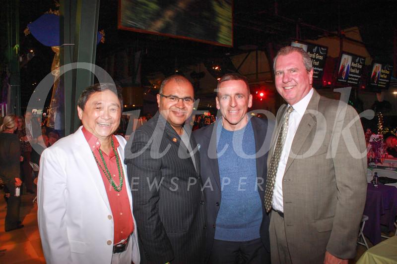 Shone Wang, former Mardi Gras event chair Lindburgh McPherson, Michael Demoratz and hospital President & CEO Dan Ausman