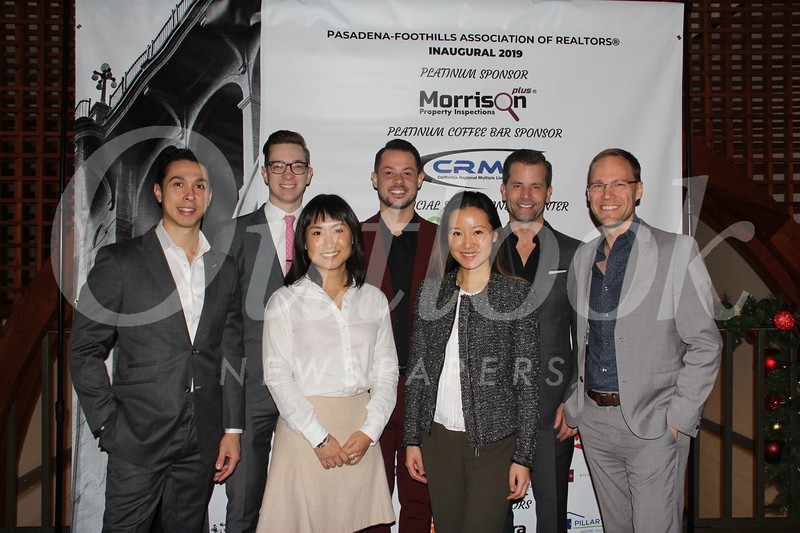 Lingyu Liu (front row, from left) and Jane Sha. Back: Eddie Aguero, Peter Owens, Chris Newman, Tim Durkovic and Jon Butler.