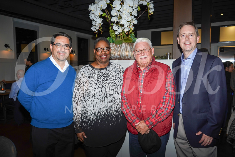 Dr. Pablo Anabalon, vice president of clinical services; Denise Jackson; Dr. Greg Bowman; and Evan Hitchcock