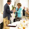 Board president Brad Hanson presents Emina Darakjy a special award