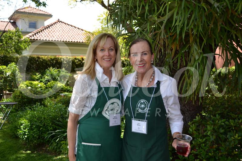 Co-chair Marie McDuffie and homeowner Ann Miller