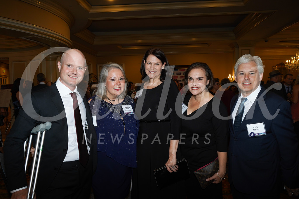Leo and Stephanie Dencik, Marie Cleaves, Sonia Solin and Chris Aldrich pose for a photo during the cocktail hour.