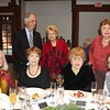 Susan Turner (seated, from left), Jeanne Adams, Nancy Iffrig and Sharon Pippen. Back: Creighton Turner, Marsha Rood and Mary Wyntor.